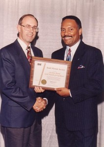 Dr. McElroy accepts Sections Board Award from SAE President Claude Verbal at the 1996 SAE International Congress and Exposition